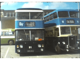 A Still image from a Super 8 vintage home movie taken in a bus museum