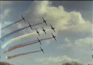 A shot taken from a super 8 home movie of the red arrows in a display from the 1970s