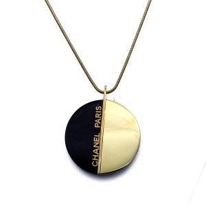 "Chanel 19 1/2"" Bisected Black Acrylic & Gilt Pendant, Autumn 2000"