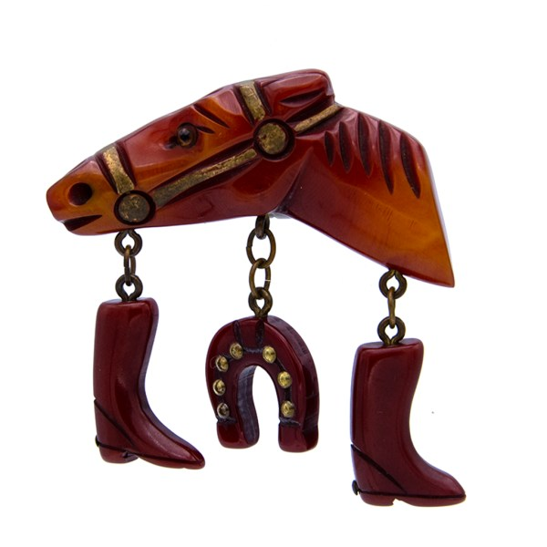 Product Photo for Bakelite Carved Butterscotch Horse Brooch with Equestrian Charms, 1945
