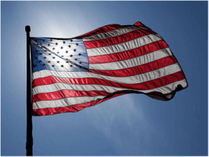 the American flag with the sun shining through it