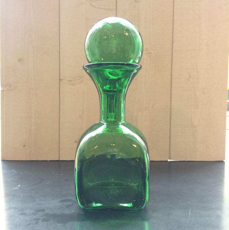 Flacon container en verre de couleur vert vintage