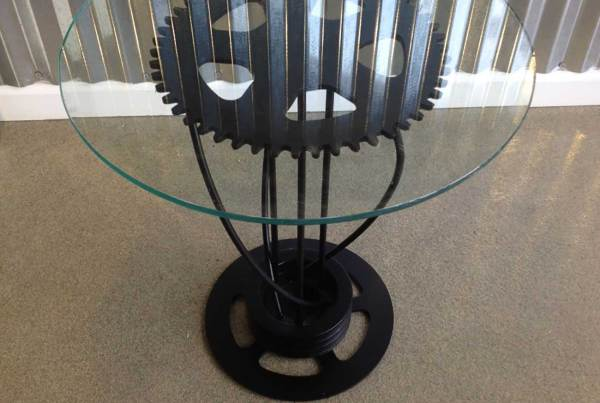 Tall glass and gear coffee table