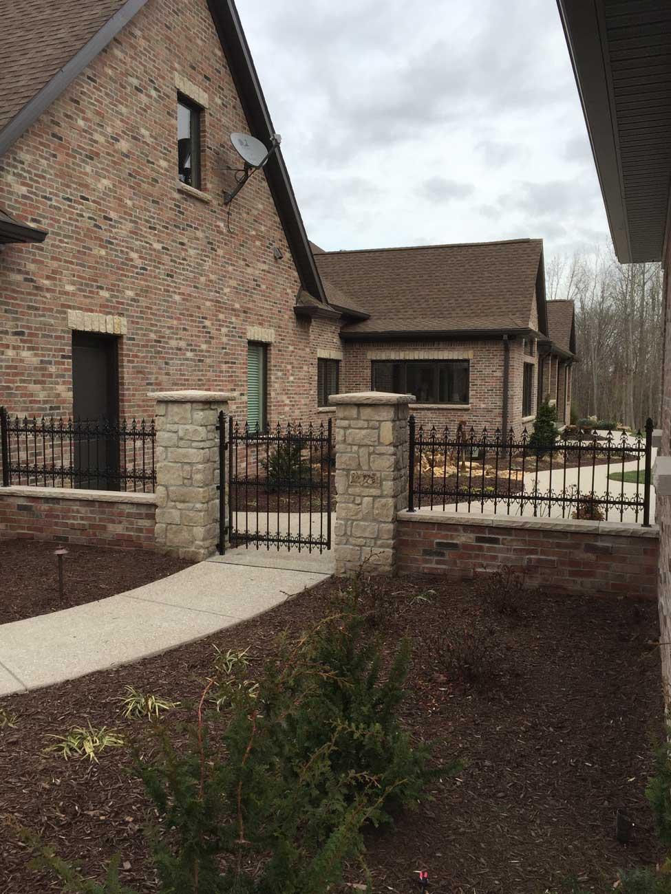 iron and stone fence