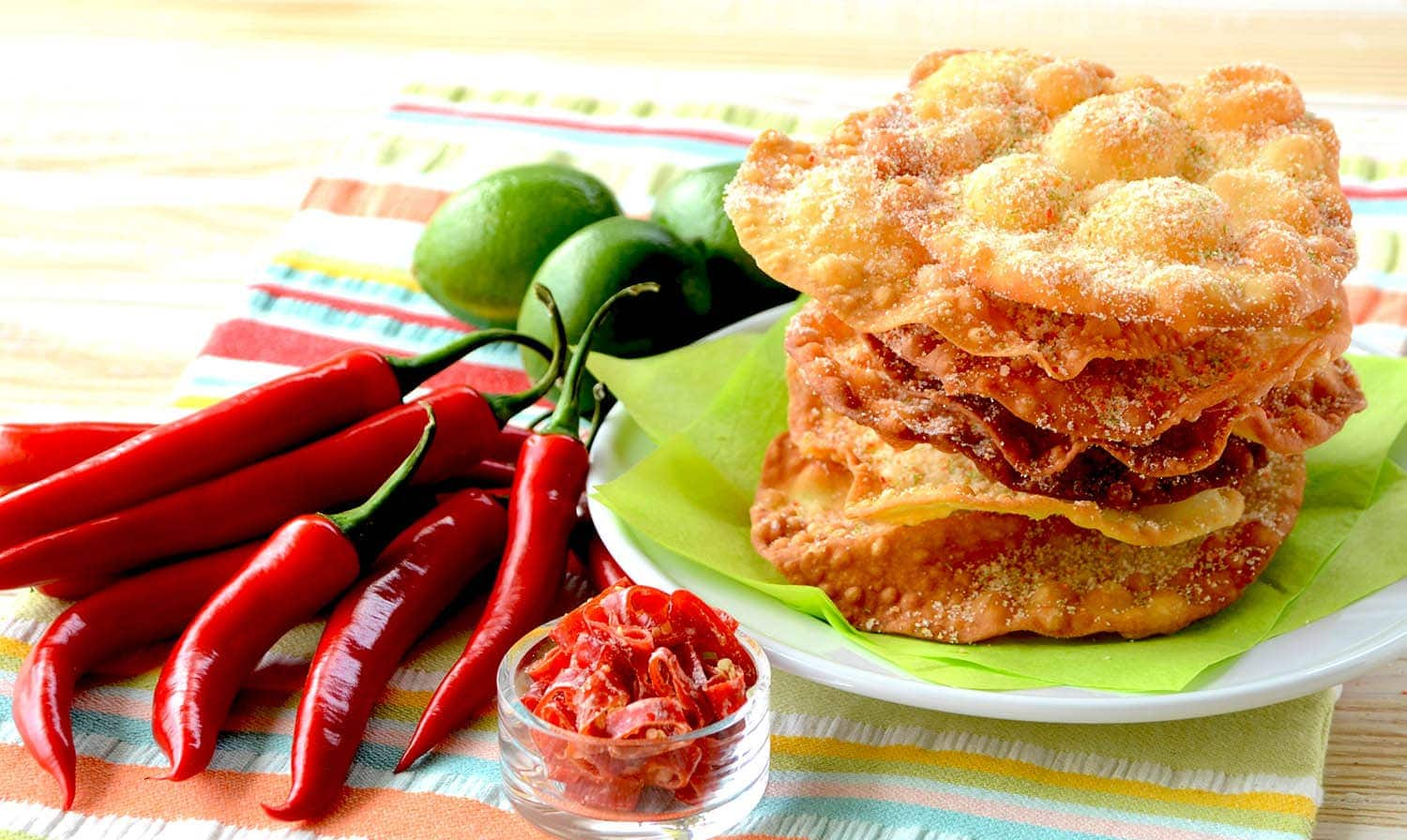 Spice up Taco Tuesday! These crispy, sweet and spicy Candied Chile and Lime Mexican Bunuelos are a perfect complement to your Cinco de Mayo or any Mexican dinner. | vintagekitty.com