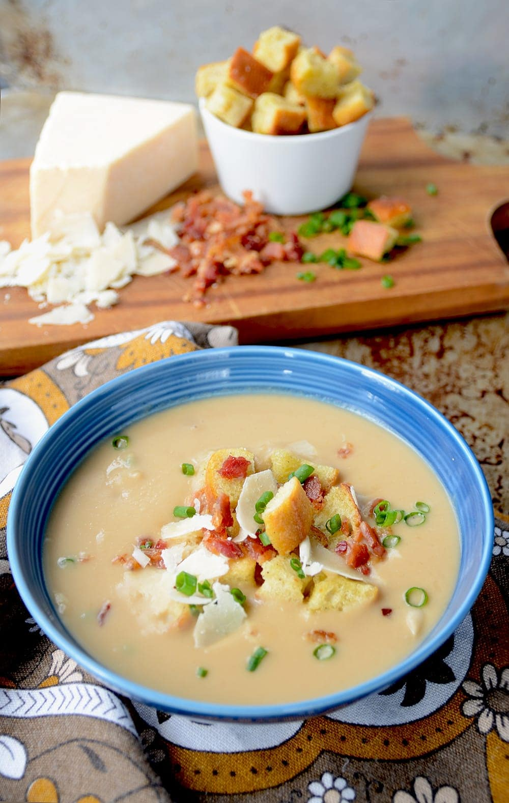 Celery Root and White Bean Soup is a hearty, pureed soup perfect for a chilly winter meal. Hot soup that's rich and creamy? Sounds like a great way to beat old man winter at his game! | vintagekitty.com