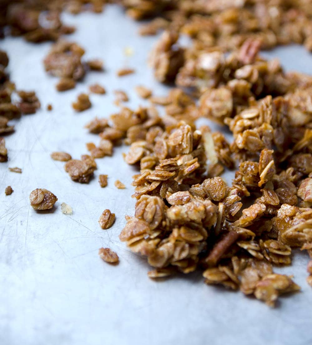 This Gingerbread Granola is super easy to make and great for snacking, yogurt parfaits or as a thoughtful homemade gift. Gingery, sweet, crunchy, nutty and so good, you'll want to eat this granola all year long! | vintagekitty.com