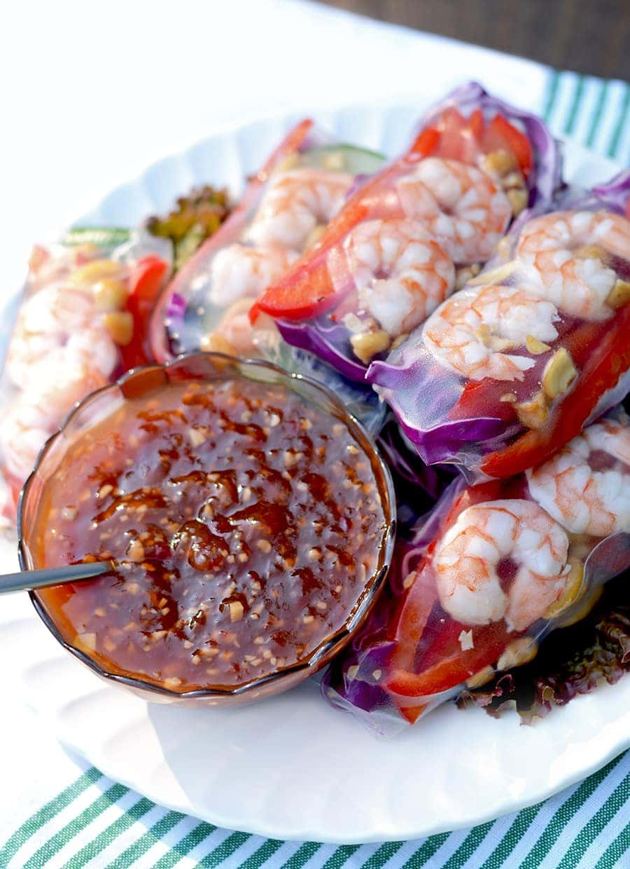 Summer Rolls with Tropical Sweet Chili Garlic Sauce are the perfect finger food for your next cookout. Serve them as an appetizer or as a side dish.
