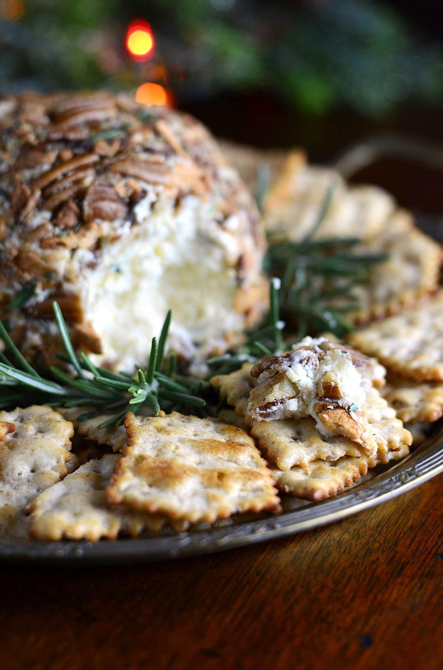 This sharp and creamy Easy Cheddar Cheese Ball will be a party favorite this holiday season! Aged cheddar is combined with cream cheese and rolled in butter roasted apple chips and pecans with a sprinkle of fresh rosemary. Just 7 ingredients for this no fuss, delicious recipe.