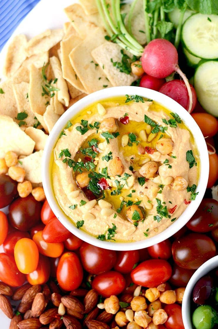 Our Zesty Harissa Hummus Recipe is the perfect beginning to a party platter. It's lemony, a little spicy and so easy to make!
