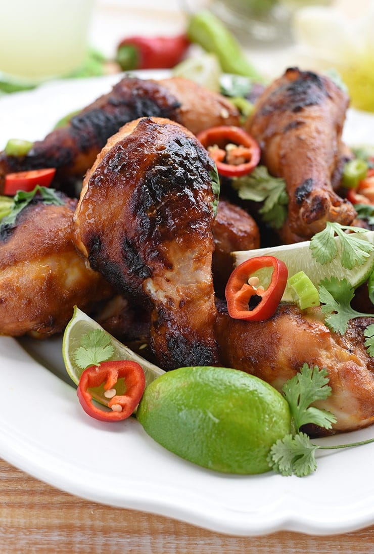 Our Sweet & Spicy Grilled Chicken Drumsticks have a Thai inspired marinade makes simple chicken drumsticks a barbecue showstopper! It's citrusy, sweet, and spicy and makes advance prep work easy!