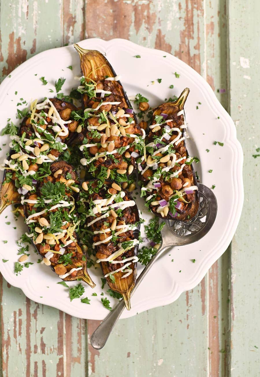 Our Stuffed Eggplant with Lemon Tahini Dressing starts with caramelized, roasted eggplant and finished with spiced chickpeas, carrots, parsley and pine nuts.