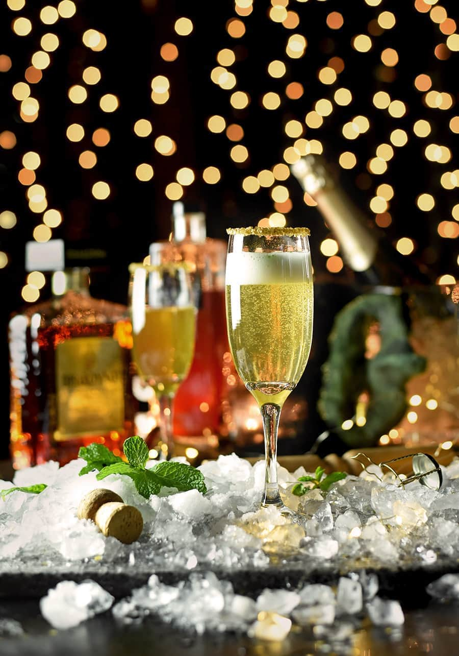 Enjoy vintage Mediterranean luxe with this Fig Prosecco Cocktail that sparkles! Whether you are celebrating New Years or a golden anniversary, this bubbly cocktail oozes elegance and class! Fig liqueur, amaretto and mint give prosecco exotic appeal. #cocktailhour #cocktail #NewYears #wedding #anniversary