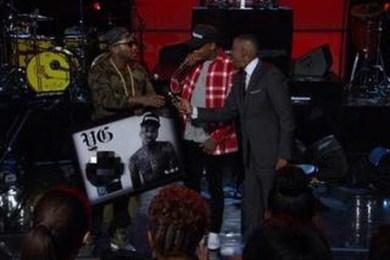 Jeezy Presents YG With A Platinum Plaque