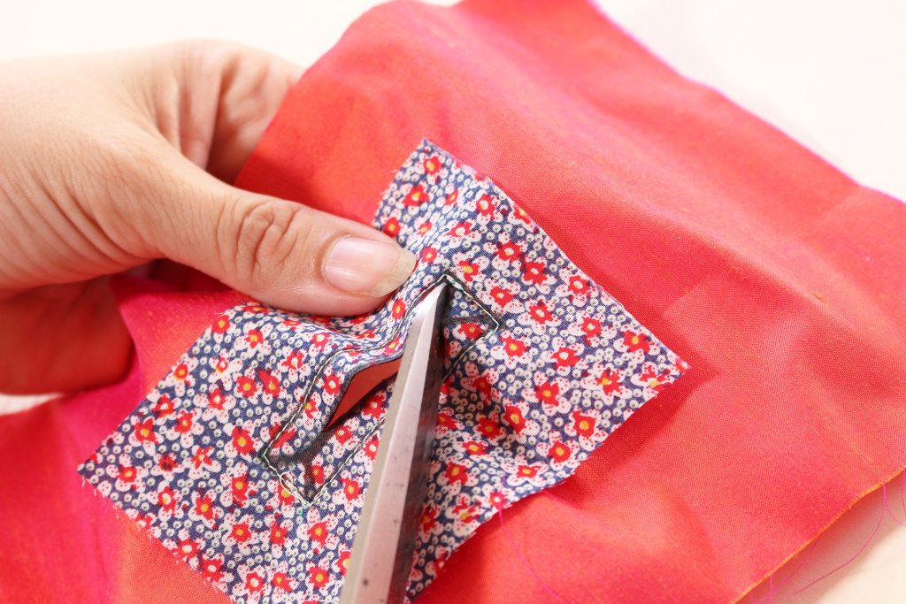Snipping guide lines on bound buttonholes. Learn how to make bound buttonholes with this tutorial! | Vintage on Tap