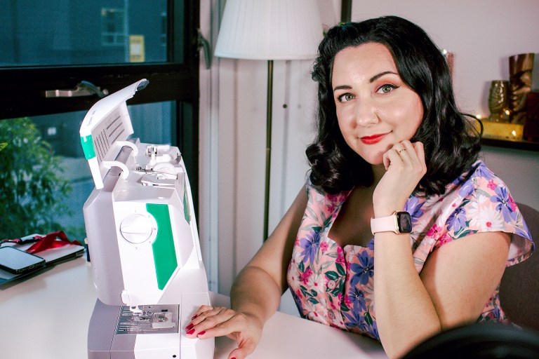 Bianca with her sewing machine, discussing why it as an investment.