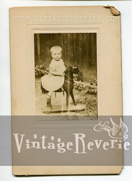 toddler on a toy horse