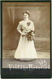 turn of the century young woman in a white dress