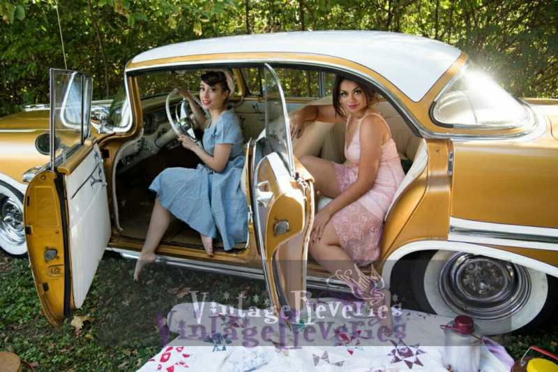 pinup models in a 1950s car