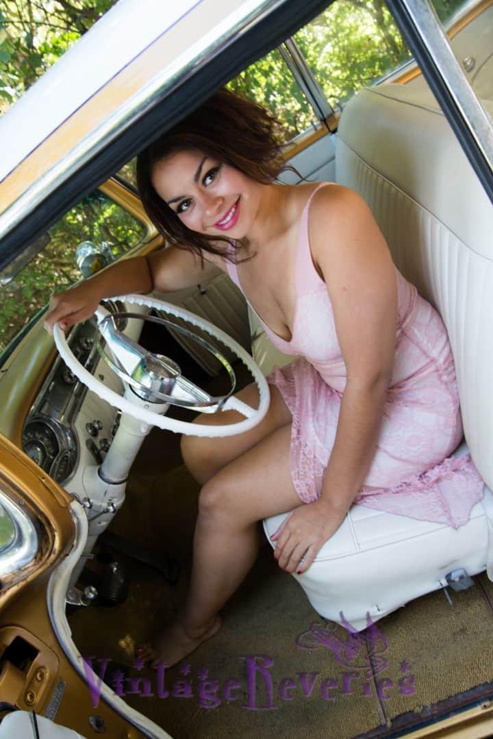 cute model in a classic car