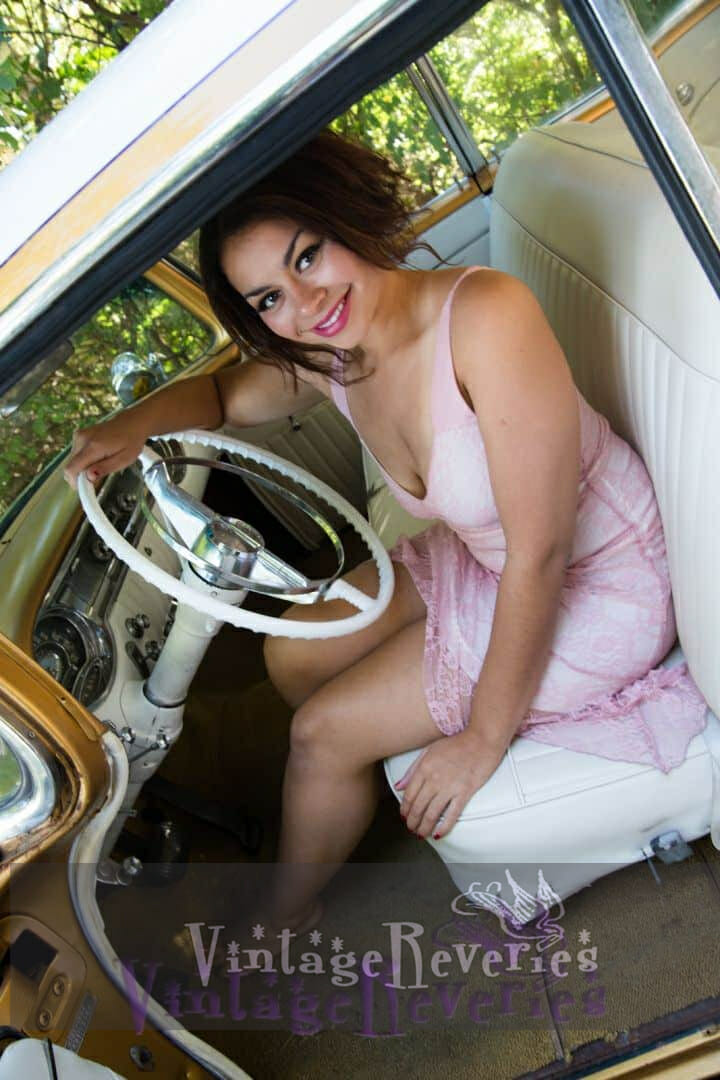 cute model in a classic car