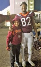 Nicholas with JM at tech game