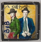 David Bowie with William Burroughs, February 1974. Photograph by Terry O'Neill with colour by David Bowie. Courtesy of The David Bowie Archive. Image © Victoria and Albert Museum