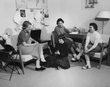 Girls in dorm room playing record, 1958