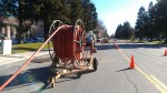 A picture of conduit for fiber optic cable being laid in a city street.