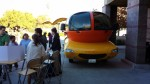 An image showing the Wienermobile and the fundraising table next to it.
