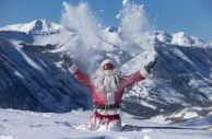 Gregory-Gull-Jr.-dressed-as-Santa-throws-fresh-snow-in-the-air-in-Crested-Butte-Colorado-on-December-20-2012.-Over-32-inches-of-snow-fell-on-the-mountains-during-the-past-seven-days.-AP-PhotoCrested-