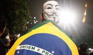 A Brazilian protester in Sao Paulo wears a Guy Fawkes mask made famous by the film V for Vendetta