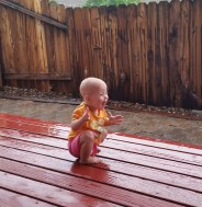 My-daughter-playing-in-seeing-rain-for-the-first-time-yesterday.