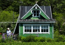 Typical pretty wooden dacha cottage in countryside of Sakhalin Island Russia