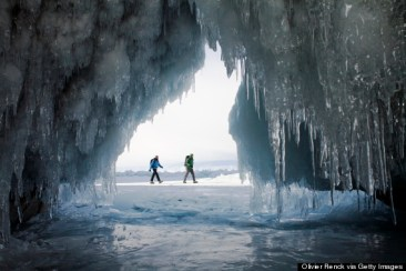 LAKE BAIKAL, OLKHON ISLAND, SIBERIA, RUSSIA-MARCH 14, 2007: Murille Ribot and Olivier Alluis hike on the frozen Lake Baikal during the winter as seen from inside a frozen cave on Olkhon Island, Siberia, Russia on March 14, 2007.