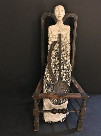 """RUTH ROSNER, Refugee Women Series CONJURING HOME [Transported By What She Had Brought/By What She Had Left Behind] plaster,wire,ash, clay, found metal objects and chair; 46""""h x 20""""w x18""""d"""