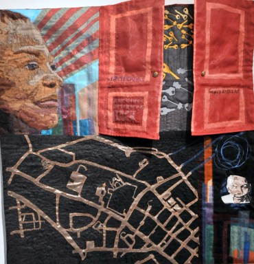 """L'Merchie Frazier, """"Reclaiming, Re-Envisioning, Rekeying District Six"""" (Barricades series), Nylon, digital embroidery, quilting, 30"""" x 30,"""" 2015"""