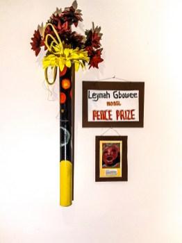 """Gail Jerauld Bos, """"Leymah Gbowee,"""" Wood, plastic, exterior paint, 6' tall, 2021"""