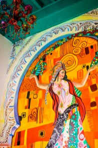 Love the almost Indian feel to this room because of this mural. http://salutmaroc.com