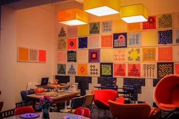 Reception area in hotel vibrant colours & modern furniture