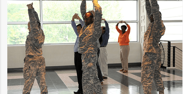 Soldiers at the U.S. Army Research Laboratory practice Tai Chi, an ancient Chinese martial art form that focus on breathing and movement. The ARL Human Research and Engineering Directorate field element in San Antonio, Texas is in the last year of a three year Mindfulness-Based Stress Reduction study that explores the value of meditation techniques for stress relief. (U.S. Army Research Laboratory photo by Larry Shank)