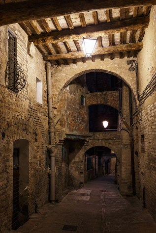 A medieval alley of the historic center of Siena, Tuscany, Italy.