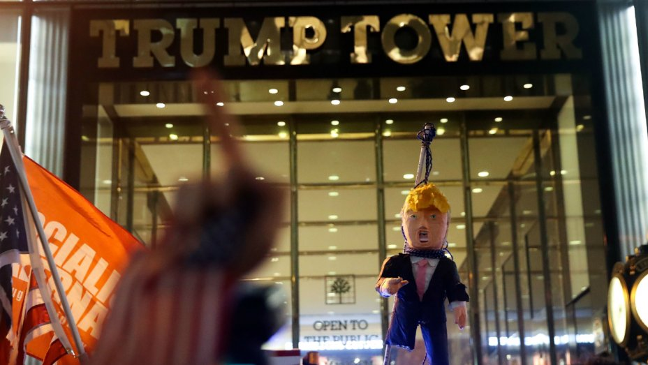 Los Angeles Protestors Burn Donald Trump's Head in Effigy