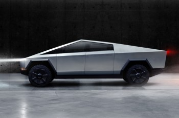 Tesla unveils electric pickup truck with angular design and armored glass