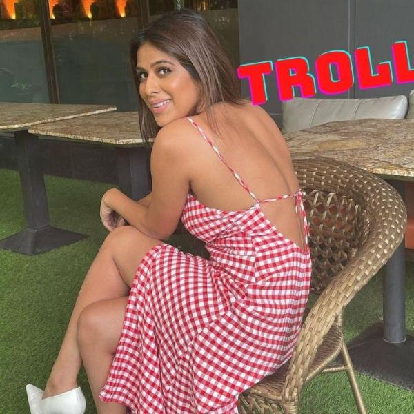 Nia Sharma Trolled For waering red checkered dress with strap sleeves and a plunging neckline