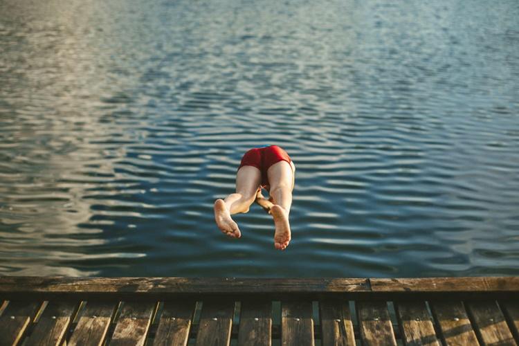 Kid Diving on Water