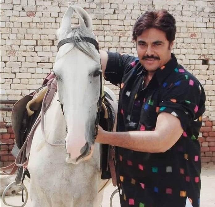 Guggu Gill With His Horse