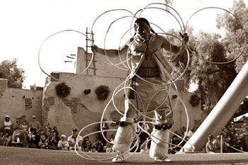 Fig 5. Potawatomi Indian, Gary Wis-Ki-Ge-Amatyuk Jr., performing an American Indian hoop dance.  Wiskigeamatyuk.com. Web. May 1 2016. Photo taken by T.J. Sinsay of Sinsay Fitography, 2009.