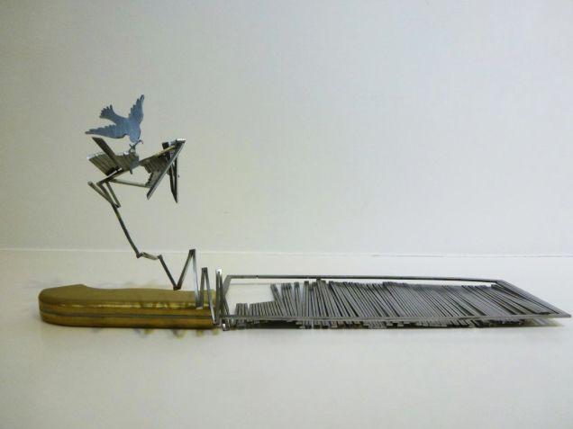 Vogel silhouet gemaakt van slagersmes