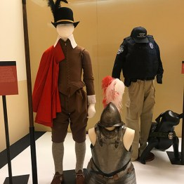 The first segment of a showcase in the exhibit, showing some of the earliest uniforms, (front) of Capitol Police uniforms.
